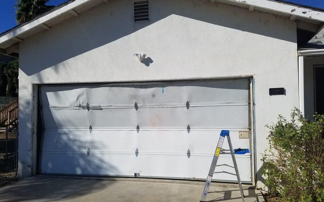 garage door panel damage